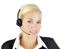 Professional woman with headset. Beautifull woman smiling in a professional way while wearing a headset. Very crisp photo Royalty Free Stock Photo