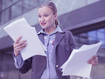 Professional woman in jacket working with documents Stock Photo