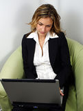 Professional woman with a laptop Stock Photography