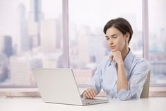 Professional woman with laptop computer Royalty Free Stock Photography