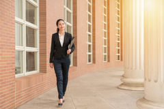 Professional woman lawyer walking in court outdoor