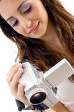 Professional woman looking video into handy cam Royalty Free Stock Photography