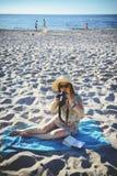 Professional woman photographer on the beach Stock Photos