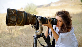 Professional woman photographer on the field Stock Photography