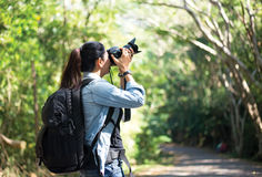 Professional woman photographer taking outdoor Royalty Free Stock Photos