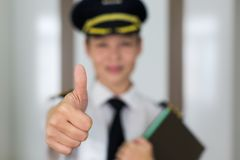 Professional woman pilot portrait giving the thumbs up stock photos