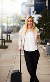 Professional woman posing on sidewalk grinning Royalty Free Stock Photo
