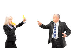 Professional woman showing a yellow card to her boss Royalty Free Stock Image