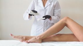 Professional woman at spa beauty salon doing epilation by sugar. stock video footage
