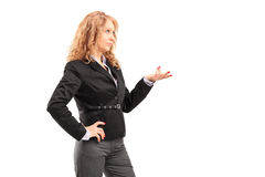 A professional woman in a suit shot during a conversation Stock Photography
