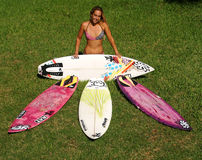 Professional Woman Surfer Cecilia Enriquez. Professional surfer girl, Cecilia Enriquez poses with her surfboards Stock Photography
