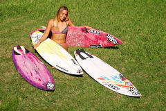 Professional Woman Surfer Cecilia Enriquez. Professional surfer girl, Cecilia Enriquez poses with her surfboards Royalty Free Stock Photography
