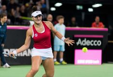 Professional woman tennis player playing a game. CLUJ NAPOCA, ROMANIA - FEBRUARY 10, 2018: Canadian tennis player Bianca Andreescu plays against Irina Begu from royalty free stock images