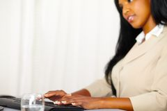 Professional woman working on computer Stock Photo