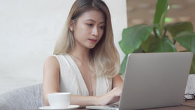 Professional woman working on laptop computer Royalty Free Stock Images