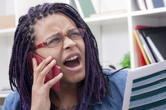 Professional woman yelling on phone Royalty Free Stock Images