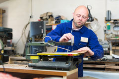 Professional woodworker using a lathe Royalty Free Stock Photography