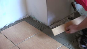 Professional work at home interior floor tiling stock video footage