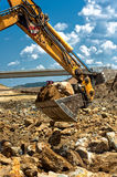 Professional worker moving excavator scoop Royalty Free Stock Photos