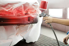 Professional worker spraying red paint Royalty Free Stock Photo