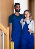 Professional workers at doorway Royalty Free Stock Photography