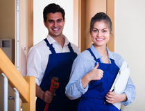 Professional workers with tools at doorway Stock Photo