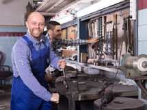 Professional workers at workshop Royalty Free Stock Photos
