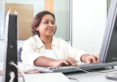 Professional working woman with jacket Stock Photography