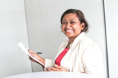Professional working woman with jacket Stock Photo
