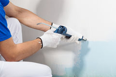 Professional Workman Applying Silicone Sealant With Caulking Gun Royalty Free Stock Photos