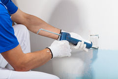 Professional Workman Applying Silicone Sealant With Caulking Gun Stock Photo