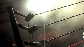 Professional Wrestling Ring Ropes Silhouette, Lit with Dramatic Lighting. Silhouette of the ropes of an American Pro Wrestling ring in a smokey arena stock footage