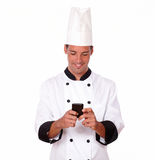 Professional young chef texting a message Stock Photos