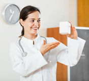 Professional young doctor offering new medicine Royalty Free Stock Photography