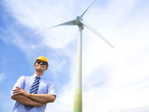 Professional young engineer standing with wind generator Royalty Free Stock Photos