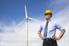 Professional young engineer standing with wind generator Royalty Free Stock Image