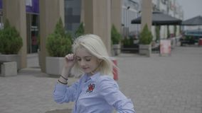 Professional young female dancer enjoying dancing showing sensual latin moves in the salsa rhythm outside in the city street -. Professional young female dancer stock footage