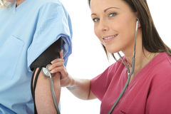 Professional Young Female Doctor Taking The Blood Pressure Of A Patient Stock Photography