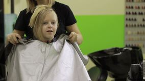 Smiling happy cute girl at the hairdressing salon stock video footage