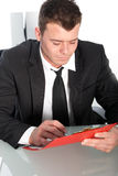 Professional young man studying a file Royalty Free Stock Images