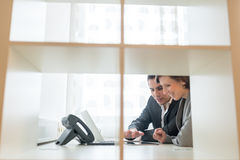 Professional young man and woman having a discussion sitting tog Stock Photo