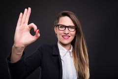 Professional young manager doing ok hand sign. After finishing project with success Stock Images