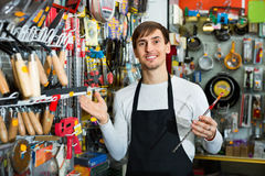 Professional young  pleasant salesman working and smiling. In building store Royalty Free Stock Photo