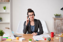 Professional young secretary is answering on calls Stock Image
