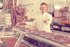 Professional young seller at butcher market Stock Image