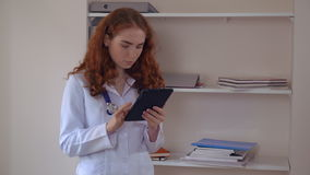Professional young therapist holding touch screen device. stock video