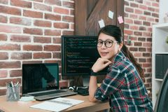 Professional young woman computer engineer. Using code language development online safety software work in office and looking at camera royalty free stock photography