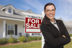 Professional Young Woman in Front of House and Sale Sign Stock Photo