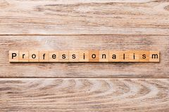 Professionalism word written on wood block. Professionalism text on wooden table for your desing, concept.  royalty free stock photography