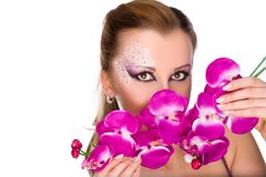 Professionally madeup girl with orchids Stock Photos